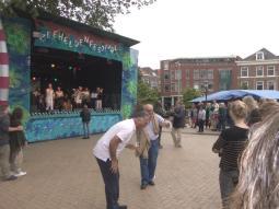 Dutch men salsa dancing at a music festival in den Haag.