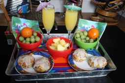 Vacation breakfast! Fruit, mimosas, cinnamon rolls.