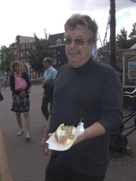 My dad eating cold herring in Amsterdam (BLEGH!)