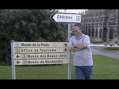 CAEN - mon pere in front of a sign