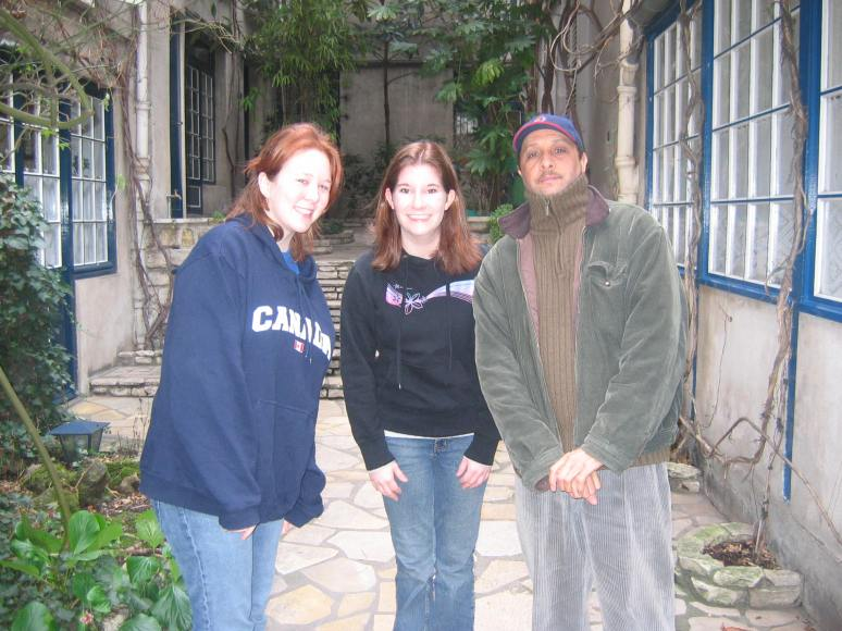 Me, my friend KP visiting me during her spring break, and le gardien for our building.